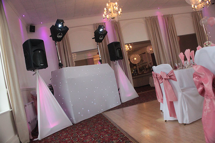 Perfect for high class wedding/corporate functions where a more subtle setup is preferred) Suitable for up to approx 120 guests in small venues. Lighting consists of two room filling computer controlled effects, uplit speaker stand scrims colour themed to match wedding colours. Choice of plain black or a starcloth covered dj booth. Sound is supplied from a state of the art digital nightclub quality playout system and two full range active speakers