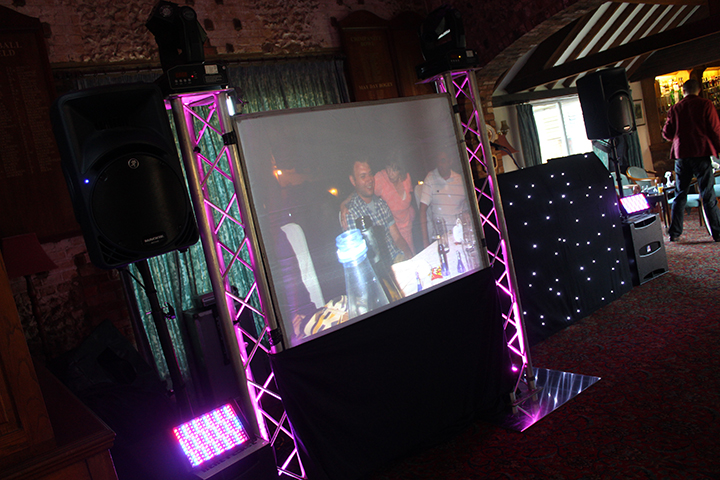 Large screen photo and video projection at a wedding at Whipsnade Park Golf Club
